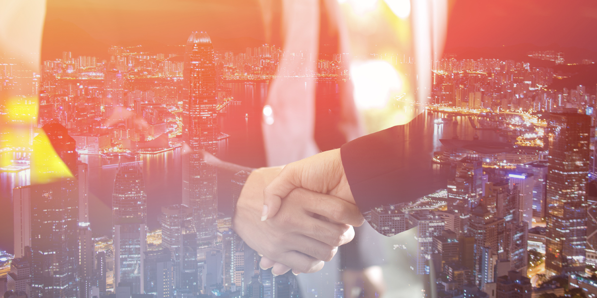 Double exposure of handshake and city, Business handshake and business people